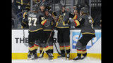 Vegas Golden Knights players celebrate after center Jonathan Marchessault, third from left, scored on the San Jose Sharks during the second period in Game 6 of a first-round NHL hockey playoff series Sunday, April 21, 2019, in Las Vegas. (AP Photo/John Locher)