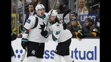 San Jose Sharks defenseman Erik Karlsson, right, celebrates after center Logan Couture, left, scored against the Vegas Golden Knights during the first period in Game 6 of a first-round NHL hockey playoff series Sunday, April 21, 2019, in Las Vegas. (AP Photo/John Locher)