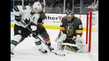 Vegas Golden Knights goaltender Marc-Andre Fleury (29) blocks a shot beside San Jose Sharks center Logan Couture (39) during the first period in Game 6 of a first-round NHL hockey playoff series Sunday, April 21, 2019, in Las Vegas. (AP Photo/John Locher)