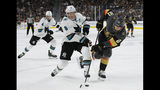 Vegas Golden Knights center Cody Eakin (21) and San Jose Sharks center Joe Pavelski (8) vie for the puck during the second period in Game 6 of a first-round NHL hockey playoff series Sunday, April 21, 2019, in Las Vegas. (AP Photo/John Locher)