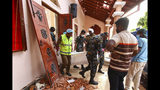 Sri Lankans carry a dead body at St. Sebastian's Church damaged in blast in Negombo, north of Colombo, Sri Lanka, Sunday, April 21, 2019. More than hundred were killed and hundreds more hospitalized with injuries from eight blasts that rocked churches and hotels in and just outside of Sri Lanka's capital on Easter Sunday, officials said, the worst violence to hit the South Asian country since its civil war ended a decade ago. (AP Photo/Chamila Karunarathne)