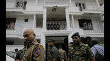 Sri Lankan security forces officers secure a site believed to be a hide out of the militants following a shoot out in Colombo, Sri Lanka, Sunday, April 21, 2019. More than hundred were killed and hundreds more hospitalized with injuries from eight blasts that rocked churches and hotels in and just outside of Sri Lanka's capital on Easter Sunday, officials said, the worst violence to hit the South Asian country since its civil war ended a decade ago. (AP Photo/Eranga Jayawardena)