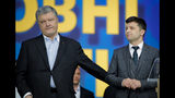Ukrainian presidential candidate and popular comedian Volodymyr Zelenskiy, left, and Ukrainian President Petro Poroshenko participate in their final electoral campaign debate at the Olympic stadium in Kiev, Ukraine, Friday, April 19, 2019. Friday is the last official day of election canvassing in Ukraine as all presidential candidates and their campaigns will be barred from campaigning on Saturday, the day before the vote. (AP Photo/Vadim Ghirda)