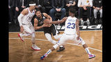 Brooklyn Nets guard Spencer Dinwiddie, center drives against Philadelphia 76ers forward Tobias Harris (33) and guard Jimmy Butler (23) during the first half of Game 4 of a first-round NBA basketball playoff series, Saturday, April 20, 2019, in New York. (AP Photo/Mary Altaffer)
