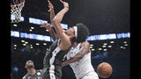 Philadelphia 76ers center Joel Embiid, right, fouls Brooklyn Nets center Jarrett Allen during the second half of Game 4 of a first-round NBA basketball playoff series, Saturday, April 20, 2019, in New York. (AP Photo/Mary Altaffer)