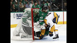 Dallas Stars goaltender Ben Bishop (30) is pushed into the net by Ben Lovejoy (21) who helps defend against a pressure from Nashville Predators' Colton Sissons (10) in the second period of Game 6 in an NHL hockey first-round playoff series in Dallas, Monday, April 22, 2019. (AP Photo/Tony Gutierrez)