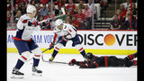 Carolina Hurricanes' Jaccob Slavin (74) falls to the ice while defending against Washington Capitals' Alex Ovechkin (8), of Russia, during the first period of Game 6 of an NHL hockey first-round playoff series in Raleigh, N.C., Monday, April 22, 2019. Ovechkin scored on the play. Capitals' Dmitry Orlov, left, of Russia, looks on. (AP Photo/Gerry Broome)