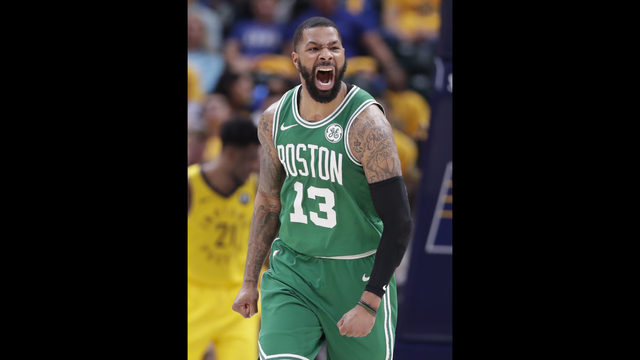 ea9f06db124 Boston Celtics forward Marcus Morris (13) celebrates during the second half  of Game 4 against the Indiana Pacers in the NBA basketball first-round  playoff ...