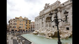 FILE - In this file photo dated Wednesday, May 2, 2018, the Trevi Fountain is cordoned-off hours before the Champions League semifinal second leg soccer match between Liverpool and Roma, in Rome, Italy. The recent devastating Notre Dame fire in Paris was a warning bell that all of Europe needs to hear since so many monuments and palaces across the continent are in need of better upkeep. National governments are increasingly looking for private donors to renovate major monuments prompting Fendi fashion house to help renovate the Trevi Fountain. (AP Photo/Riccardo De Luca, FILE)