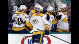 Nashville Predators left wing Austin Watson (51) is congratulated by the bench after scoring against the Dallas Stars in the first period of Game 6 in an NHL hockey first-round playoff series in Dallas, Monday, April 22, 2019. (AP Photo/Tony Gutierrez)