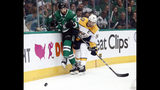 Dallas Stars' Justin Dowling (37) and Nashville Predators' Roman Josi (59) slam against the boards chasing after the puck in the first period of Game 6 in an NHL hockey first-round playoff series in Dallas, Monday, April 22, 2019. (AP Photo/Tony Gutierrez)