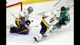 Nashville Predators' Pekka Rinne (35) and Ryan Ellis (4) watch a shot by Dallas Stars' Andrew Cogliano (17) glance off Rinne in the third period of Game 6 in an NHL hockey first-round playoff series in Dallas, Monday, April 22, 2019. (AP Photo/Tony Gutierrez)