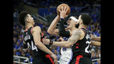Orlando Magic's Aaron Gordon, center, looks for a shot as he gets between Toronto Raptors' Danny Green, left, and Fred VanVleet, right, during the second half in Game 4 of a first-round NBA basketball playoff series, Sunday, April 21, 2019, in Orlando, Fla. (AP Photo/John Raoux)