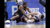 Toronto Raptors' Kawhi Leonard, left, and Orlando Magic's Nikola Vucevic battle for a loose ball during the second half in Game 4 of a first-round NBA basketball playoff series, Sunday, April 21, 2019, in Orlando, Fla. The play resulted in a jump ball. (AP Photo/John Raoux)