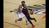 Portland Trail Blazers guard Damian Lillard (0) and Oklahoma City Thunder forward Jerami Grant (9) collide as Lillard carries the ball upcourt in the second half of Game 4 of an NBA basketball first-round playoff series Sunday, April 21, 2019, in Oklahoma City. Portland won 111-98. (AP Photo/Alonzo Adams)