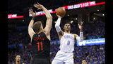 Oklahoma City Thunder guard Russell Westbrook (0) goes to the basket as Portland Trail Blazers forward Meyers Leonard (11) defends in the first half of Game 4 of an NBA basketball first-round playoff series Sunday, April 21, 2019, in Oklahoma City. (AP Photo/Alonzo Adams)