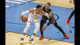 Oklahoma City Thunder guard Russell Westbrook (0) drives to the basket as Portland Trail Blazers guard Damian Lillard (0) defends in the first half of Game 4 of an NBA basketball first-round playoff series Sunday, April 21, 2019, in Oklahoma City. (AP Photo/Alonzo Adams)