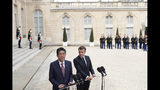 French President Emmanuel Macron, right, and Japan's Prime Minister Shinzo Abe answer reporters before their talks at the Elysee Palace, Tuesday, April 23, 2019 in Paris. (AP Photo/Thibault Camus)