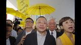 Occupy Central leaders, from left, Chan Kin-man, wearing glasses, Benny Tai, Chu Yiu-ming and Tanya Chan enter a court in Hong Kong, Wednesday, April 24, 2019. The court is preparing to sentence nine leaders of massive 2014 pro-democracy protests convicted last month of public nuisance offenses. The sentences to be handed down Wednesday are seen as an effort by the government of the semi-autonomous Chinese territory to draw a line under the protests. (AP Photo/Kin Cheung)