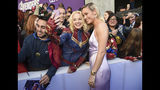 "Brie Larson takes a selfie with a fan as she arrives at the premiere of ""Avengers: Endgame"" at the Los Angeles Convention Center on Monday, April 22, 2019. (Photo by Chris Pizzello/Invision/AP)"