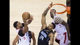 Toronto Raptors forward Norman Powell, left, drives to the net against Orlando Magic center Khem Birch (24) during the second half in Game 5 of a first-round NBA basketball playoff series, Tuesday, April 23, 2019 in Toronto. (Nathan Denette/Canadian Press via AP)