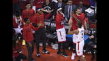 Toronto Raptors forward Kawhi Leonard (2) celebrates with teammates after being pulled from the game against the Orlando Magic during the second half in Game 5 of a first-round NBA basketball playoff series, Tuesday, April 23, 2019 in Toronto. (Nathan Denette/Canadian Press via AP)