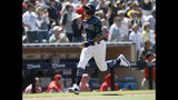 San Diego Padres' Manny Machado scores on a two-run double by Wil Myers during the third inning of a baseball game against the Cincinnati Reds in San Diego, Sunday, April 21, 2019. (AP Photo/Alex Gallardo)
