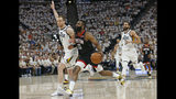 Houston Rockets guard James Harden (13) drives against Utah Jazz forward Joe Ingles (2) in the first half during Game 4 of a first-round NBA basketball playoff series Monday, April 22, 2019, in Salt Lake City. (AP Photo/Rick Bowmer)