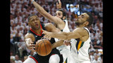 Utah Jazz's Rudy Gobert, right, and Ricky Rubio, rear, defend against Houston Rockets guard Eric Gordon, left, as he passes the ball in the first half during Game 4 of a first-round NBA basketball playoff series, Monday, April 22, 2019, in Salt Lake City. (AP Photo/Rick Bowmer)