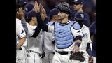 Tampa Bay Rays catcher Mike Zunino celebrates with teammates after the team defeated the Kansas City Royals during a baseball game Tuesday, April 23, 2019, in St. Petersburg, Fla. (AP Photo/Chris O'Meara)