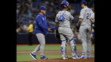 Kansas City Royals manager Ned Yost, left, prepares to take the ball from starting pitcher Homer Bailey, right, as he is taken out of the game against the Tampa Bay Rays during the second inning of a baseball game Tuesday, April 23, 2019, in St. Petersburg, Fla. Looking on is Royals catcher Martin Maldonado. (AP Photo/Chris O'Meara)