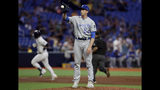 Kansas City Royals pitcher Tim Hill gets a new baseball as Tampa Bay Rays' Mike Zunino runs around the bases after his home run during the sixth inning of a baseball game Tuesday, April 23, 2019, in St. Petersburg, Fla. (AP Photo/Chris O'Meara)