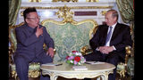 FILE - In this file Saturday, Aug. 4, 2001 file photo, Russian President Vladimir Putin, right, listens to North Korean leader Kim Jong Il, during their meeting in Moscow. North Korean leader Kim Jong Un's summit with Russian President Vladimir Putin this week expands a diplomatic charm offensive that has included meetings with leaders from China, South Korea and the United States.(Sergei Velichkin/TASS/Sputnik Kremlin via AP, File)