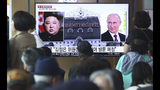 "People watch a TV screen showing images of North Korean leader Kim Jong Un, left, and Russian President Vladimir Putin, right, during a news program at the Seoul Railway Station in Seoul, South Korea, Tuesday, April 23, 2019. North Korea confirmed Tuesday that Kim will soon visit Russia to meet with Putin in a summit that comes at a crucial moment for tenuous diplomacy meant to rid the North of its nuclear arsenal. The Korean letters on the screen read:: ""Kim Jong Un plans to visit Russia ."" (AP Photo/Ahn Young-joon)"