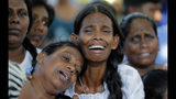 Relatives of the Burlington family weep during the funeral of their family members who were killed in the Easter Sunday bombings in Colombo, Sri Lanka, Tuesday, April 23, 2019. The six near-simultaneous attacks on three churches and three luxury hotels and three related blasts later Sunday were the South Asian island nation's deadliest violence in a decade while Sri Lanka police arrested 40 suspects in the wake of a state of emergency that took effect Tuesday giving the military war-time powers. (AP Photo/Eranga Jayawardena)