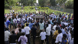 Sri Lankans prepare to bury the coffins carrying remains of Berington Joseph, left, and Burlington Bevon, who were killed in the Easter Sunday bombings in Colombo, Sri Lanka, Tuesday, April 23, 2019. The six near-simultaneous attacks on three churches and three luxury hotels and three related blasts later Sunday were the South Asian island nation's deadliest violence in a decade while Sri Lanka police arrested 40 suspects in the wake of a state of emergency that took effect Tuesday giving the military war-time powers. (AP Photo/Eranga Jayawardena)