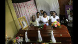 A Sri Lankan family mourns next to the coffin of their family member, a victim of Easter Sunday bombing, in Colombo, Sri Lanka, Tuesday, April 23, 2019. The six near-simultaneous attacks on three churches and three luxury hotels and three related blasts later Sunday were the South Asian island nation's deadliest violence in a decade while Sri Lanka police arrested 40 suspects in the wake of a state of emergency that took effect Tuesday giving the military war-time powers. (AP Photo/Eranga Jayawardena)
