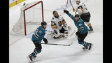 Vegas Golden Knights goaltender Marc-Andre Fleury, center, reacts between San Jose Sharks right wing Timo Meier (28) and center Tomas Hertl (48) after Sharks' Logan Couture scored a goal during the third period of Game 7 of an NHL hockey first-round playoff series in San Jose, Calif., Tuesday, April 23, 2019. (AP Photo/Jeff Chiu)