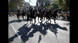 Riders participate in a march celebrating ANZAC Day, a national day of remembrance in Australia and New Zealand that commemorates those that served and died in all wars, conflicts, and while peacekeeping, in Sydney, Australia, Thursday, April 25, 2019. (AP Photo/Rick Rycroft)