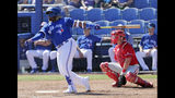 FILE - In this Feb. 28, 2019, file photo, Toronto Blue Jays' Vladimir Guerrero Jr., left, follows through with a double as Philadelphia Phillies catcher Andrew Knapp looks on in the third inning of a spring training baseball game in Dunedin, Fla. The Toronto Blue Jays will promote top prospect Vladimir Guerrero Jr. before their game against the Oakland Athletics, on Friday, April 26. (AP Photo/Lynne Sladky, File)