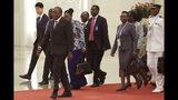 Kenyan President Uhuru Kenyatta, left, arrives the venue of meeting with Chinese President Xi Jinping, unseen, at the Great Hall of the People in Beijing, China Thursday, April 25, 2019. (Kenzaburo Fukuhara/Pool Photo via AP)