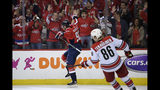 Washington Capitals center Evgeny Kuznetsov (92), of Russia, celebrates his goal during the second period of Game 7 of an NHL hockey first-round playoff series as Carolina Hurricanes left wing Teuvo Teravainen (86) skates by, Wednesday, April 24, 2019, in Washington. (AP Photo/Nick Wass)
