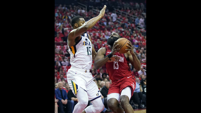 8eb5eb467908 Houston Rockets guard James Harden (13) drives to the basket against Utah  Jazz forward Derrick Favors (15) during the first half in Game 5 of an NBA  ...