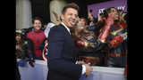 "Jeremy Renner takes a selfie with a fan as he arrives at the premiere of ""Avengers: Endgame"" at the Los Angeles Convention Center on Monday, April 22, 2019. (Photo by Chris Pizzello/Invision/AP)"