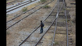 """A Central American migrant waits on the train tracks during his journey toward the US-Mexico border, in Ixtepec, Oaxaca State, Mexico, Tuesday, April 23, 2019. """"Nobody is ever going to be able to stop the flow of migration,"""" migrant rights activist Rev. Alejandro Solalinde said in a recent interview. (AP Photo/Moises Castillo)"""