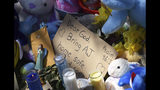 """A makeshift memorial grows Monday, April 22, 2019 outside the Dole Avenue home of Andrew """"AJ"""" Freund, age 5, in Crystal Lake, Ill. Police and the FBI continue their investigation into the missing boy. (Paul Valade/Daily Herald via AP)"""