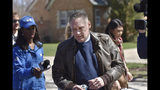 """Andrew Freund Sr., the father of the missing 5-year-old Andrew """"AJ"""" Freund, walks near his home on Dole Avenue in Crystal Lake, Ill. on Friday, April 19, 2019 as members of the media try to speak with him. Police are investigating the boy's disappearance and are focusing their attention on the boy's home. (John Starks/Daily Herald via AP)"""