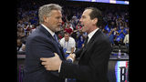 Philadelphia 76ers head coach Brett Brown, left, talks with Brooklyn Nets head coach Kenny Atkinson, right, following Game 5 of a first-round NBA basketball playoff series, Tuesday, April 23, 2019, in Philadelphia. The 76ers won 122-100. (AP Photo/Chris Szagola)