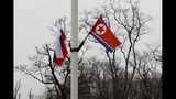 Flags of Russia and North Korea, right, are seen along the road on Russky Island, in Vladivostok, Russia, Tuesday, April 23, 2019. Russian President Vladimir Putin will meet with North Korean leader Kim Jong Un for a much-anticipated summit on upcoming Thursday, a Kremlin adviser said, putting an end to weeks of speculation about when and where it would take place. (AP Photo/Mari Borodina)