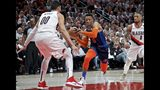 Oklahoma City Thunder guard Russell Westbrook, center, drives to the basket past Portland Trail Blazers guard Damian Lillard, right, and center Enes Kanter, left, during the first half of Game 5 of an NBA basketball first-round playoff series, Tuesday, April 23, 2019, in Portland, Ore. (AP Photo/Craig Mitchelldyer)